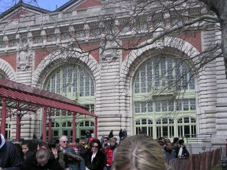 First sight of the Ellis Island Museum at arrival by boat