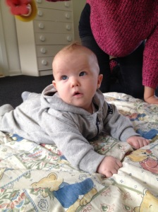 A four months old baby looking at things in movement