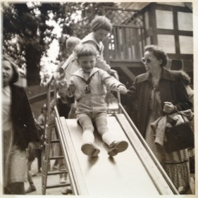 My twin Brother at the playground with our mother to the right and me behind 1955