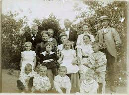 My grandmother Asta no. two from right in the back and all her cousins. Ellen is sitting on the lap of her older sister Julie in the middle. picture from about 1906