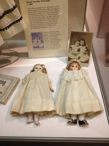Two dolls at Sudbury Hall. One is worn and used by the surviving sister