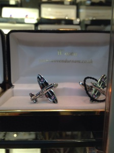Cuff link as small Spitfire planes