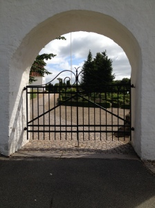 Arch entrance at a village church in Denmark