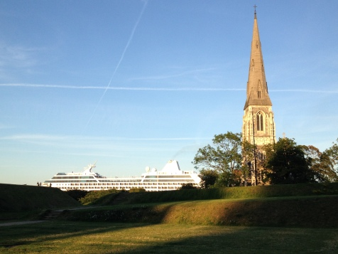 St. Alban's Church is passed by a cruise liner