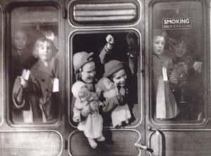 Evacuees waving goodbye to their families