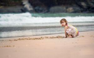 """Girl on a beach """"Wallpaperup"""""""