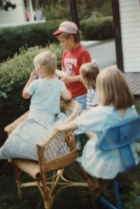 My children and a friend are playing in the basket chair in Sweden