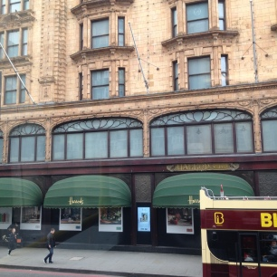 Harrods' fine windows in Art Nouveau seen from a bus