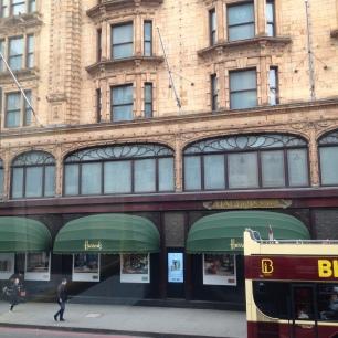 Harrods' fine windows in Art Nouveau seen from a bus
