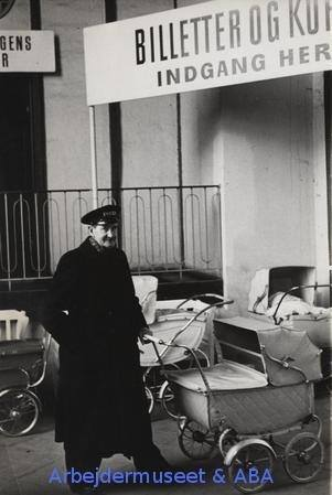 A guard watching over babies somewhere in Copenhagen in the 1950s