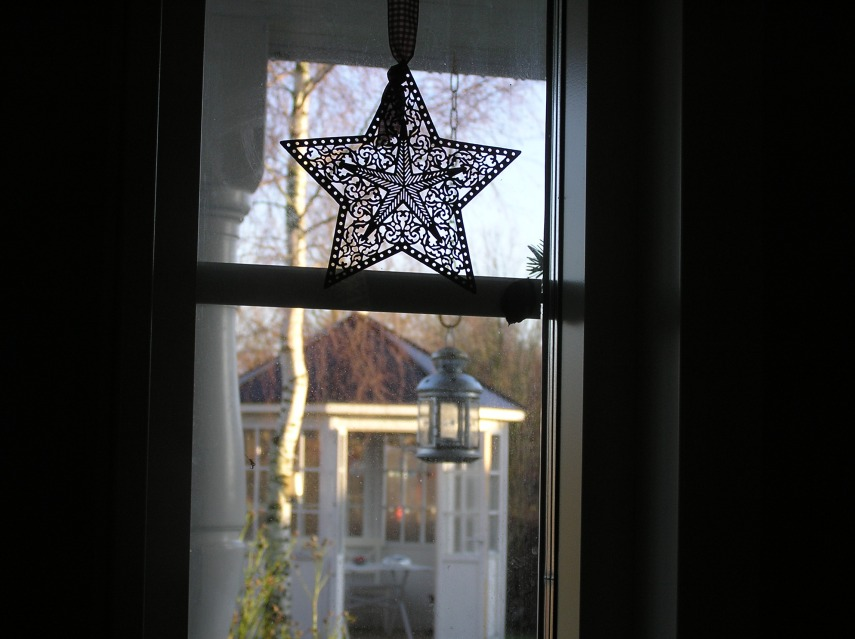 A bronze Christmas star in my small window