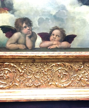 A close-up Raphael's angels underneath the big painting at Dresden Gemälde Alte Meister