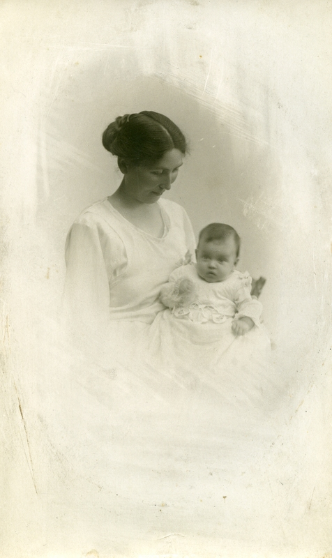 My grandmother with her first-born Eva at her christening May 1921