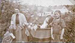 My mother Ruth with her two sisters and her grandmother Laura at the pram. In the background you see the train rails and the hospital