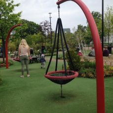 The playground with soft synthetic grass