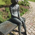 A statue of a sitting girl in Eksjö