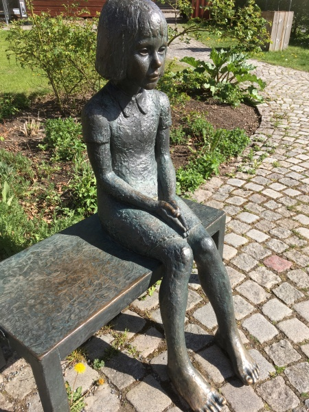 A statue of a sitting girl in Eksjoe