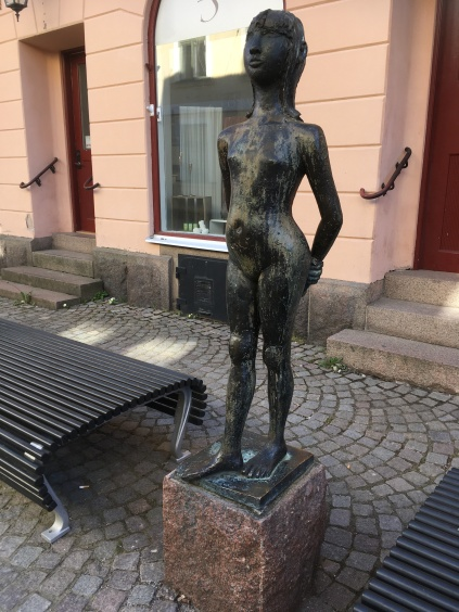 A statue of girl in the cobbled street in Eksjö