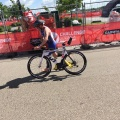 One of the fast athletes running with his bike tostart
