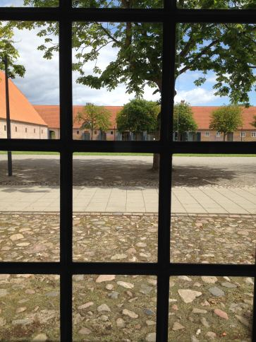 Looking out at the inner yard from a hotel window in the former stable