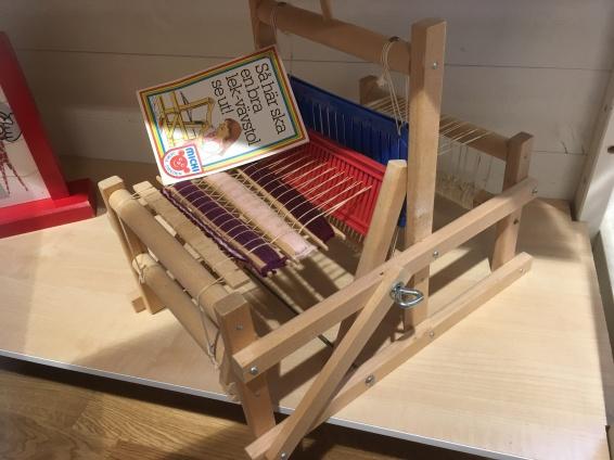 A girls' weaving tool