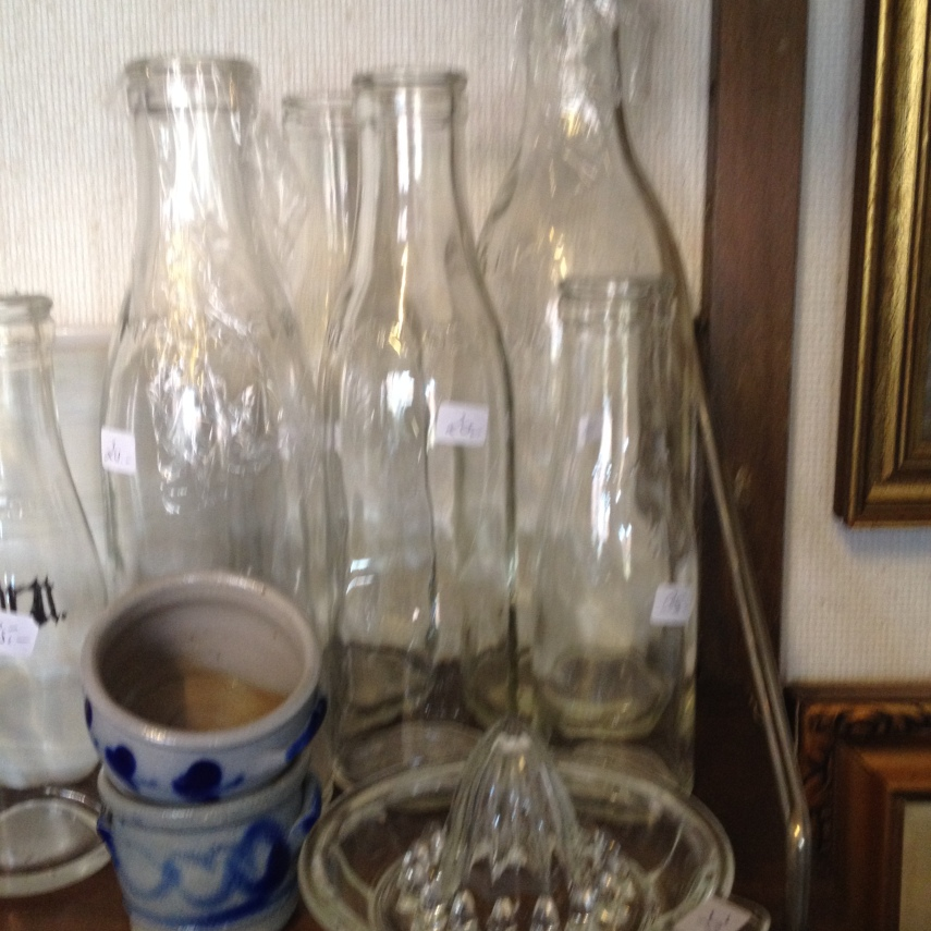 old milk bottles and other kitchen ware