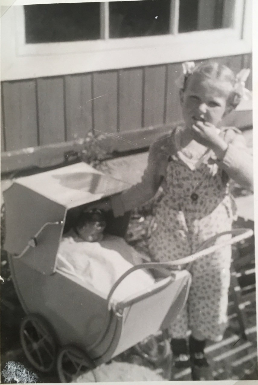 A.M. and her doll pram and composition doll