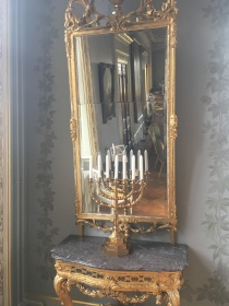 A mirror and a menorah at Fuglsang Manor House