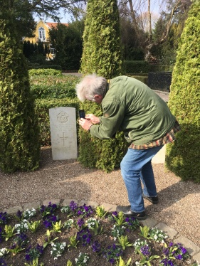 Henry taking a photo of the allied airmen graves at Svinoe