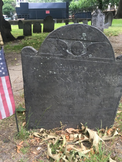 Central Burying Ground in Boston Common. A small angel is carved above the gravestone of a four-month-old girl dead in 1792