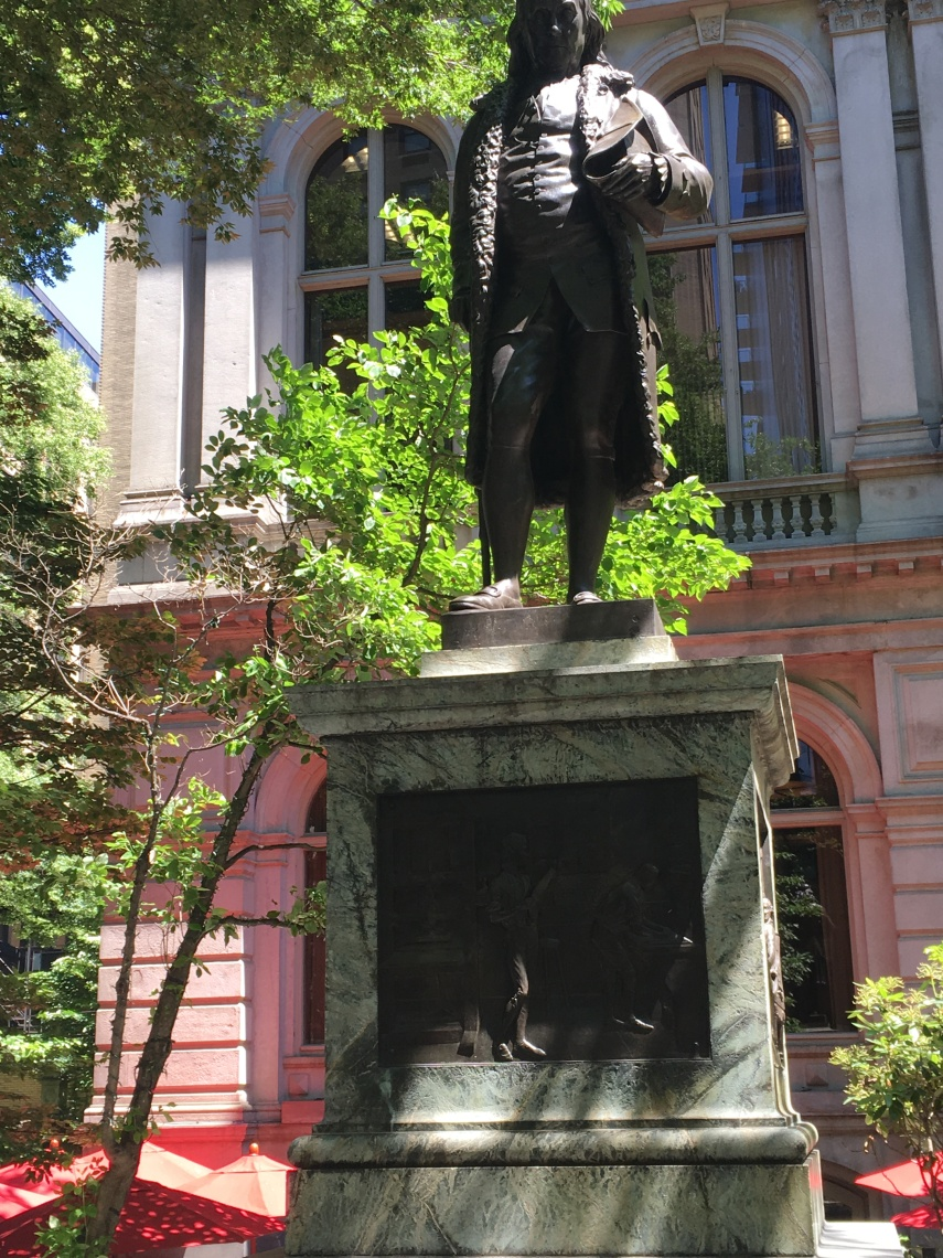 A statue of Benjamin Franklin where his old Latin School once was