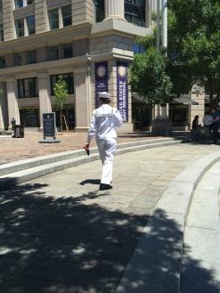 US Navy Memorial and a visiting Navy Sailor