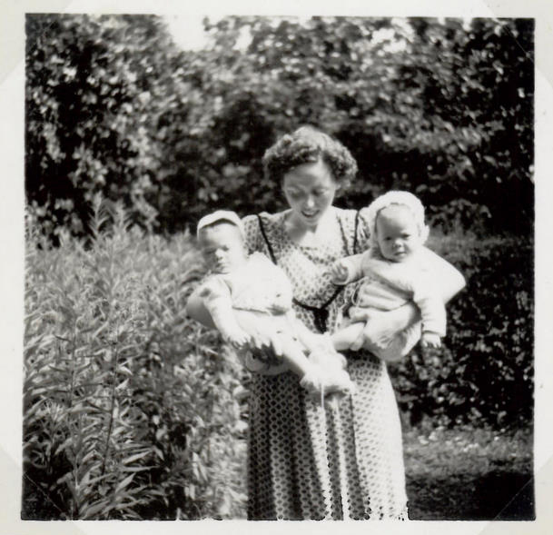 Our mother with us in my grandparents' garden summer 1951
