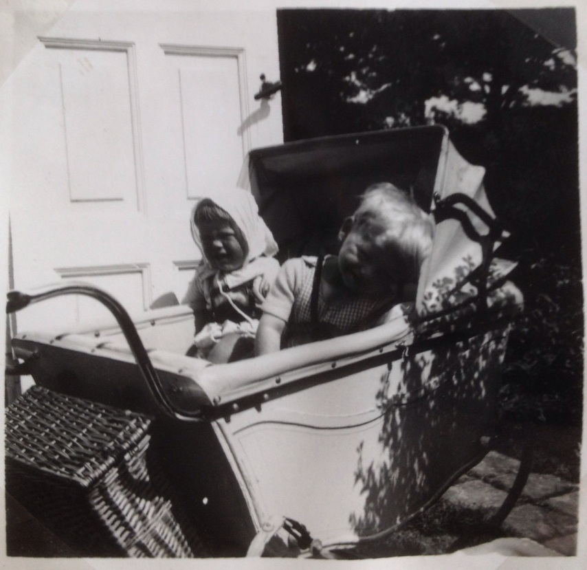 In our pram securely fastened in our harness at the summer house summer 1952