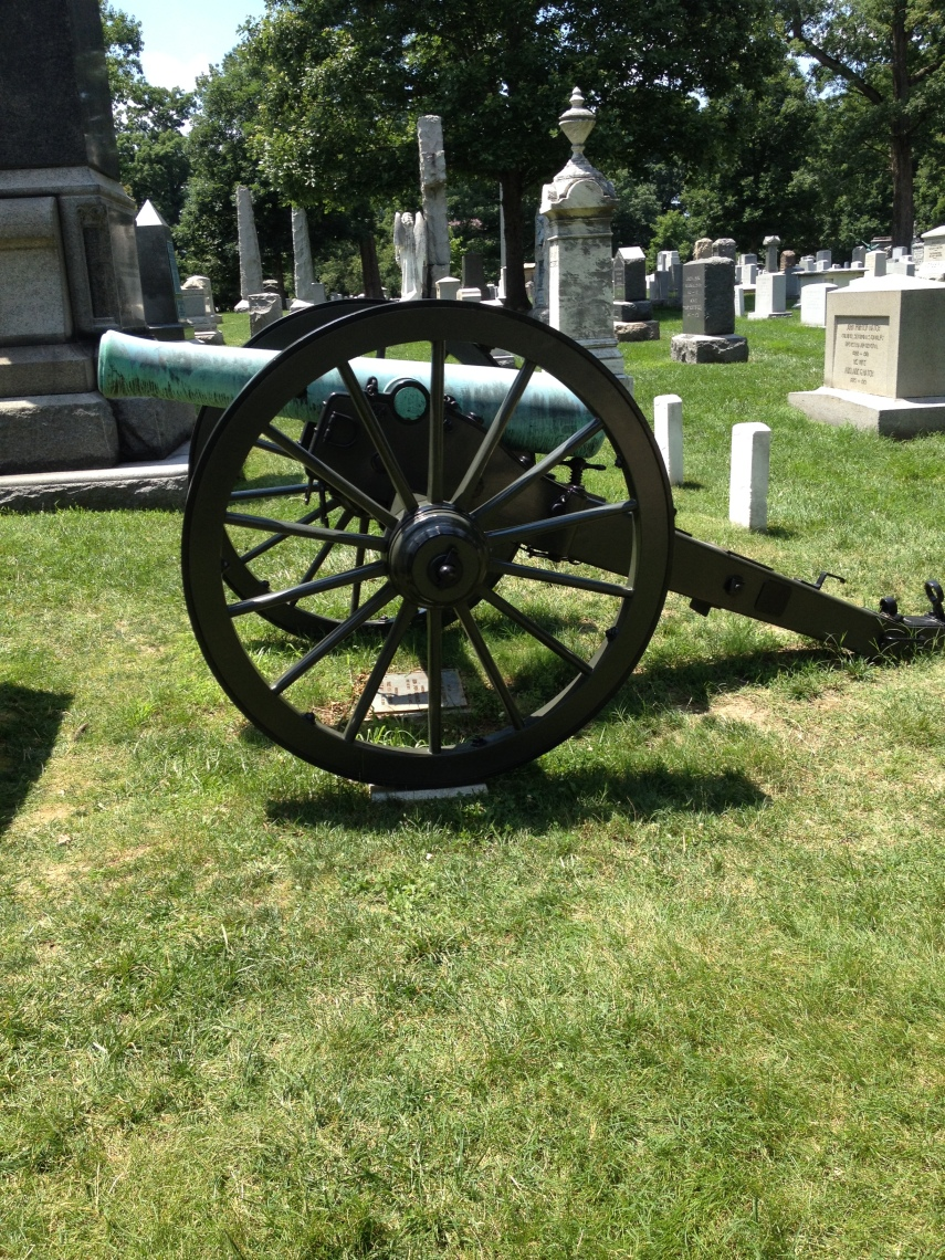 Arlington National Cemetery, a gravestone from the Civil war. Major General W.F. Randolph wished to be buried under his canon from the Civil War. Since then it is not allowed anymore.
