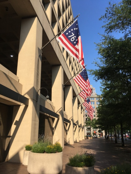 Washington FBI Building displaying all US Flags. The Penn Quarter, Pennsylvania Avenue