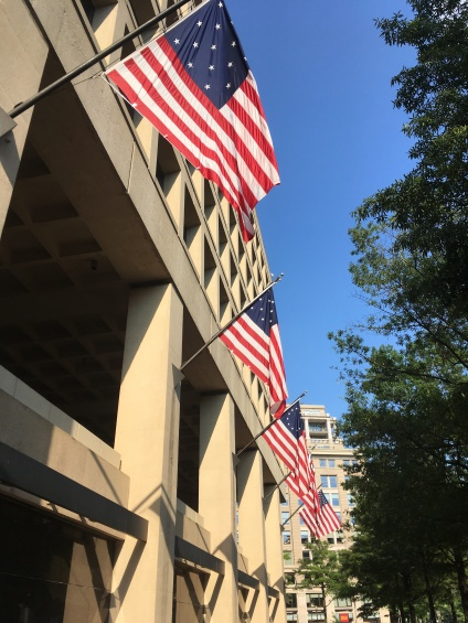 Washington FBI Building displaying all US Flags. The Penn Quarter, Pennsylvania Avenue