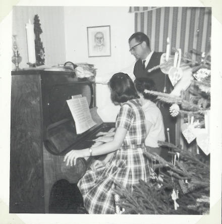 Christmas 1962. Lit candles on the three