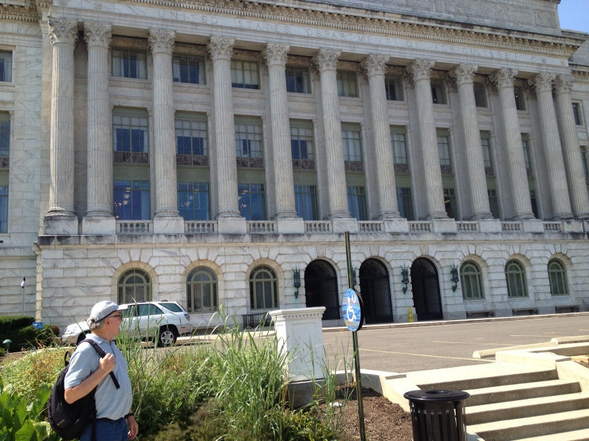 Henry, a scientist in pig nutrition, looking at The Department of Agriculture in Washington, D.C.