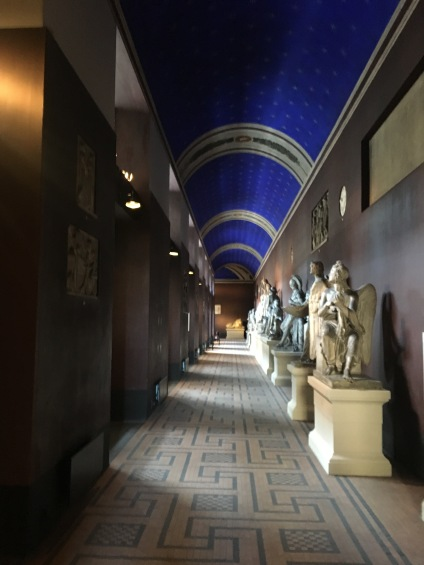Looking down at one of the corridors with sculptures in plaster casts