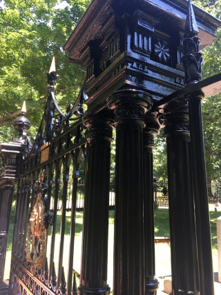 The iron-cast fence surrounding the Monticello Graveyard