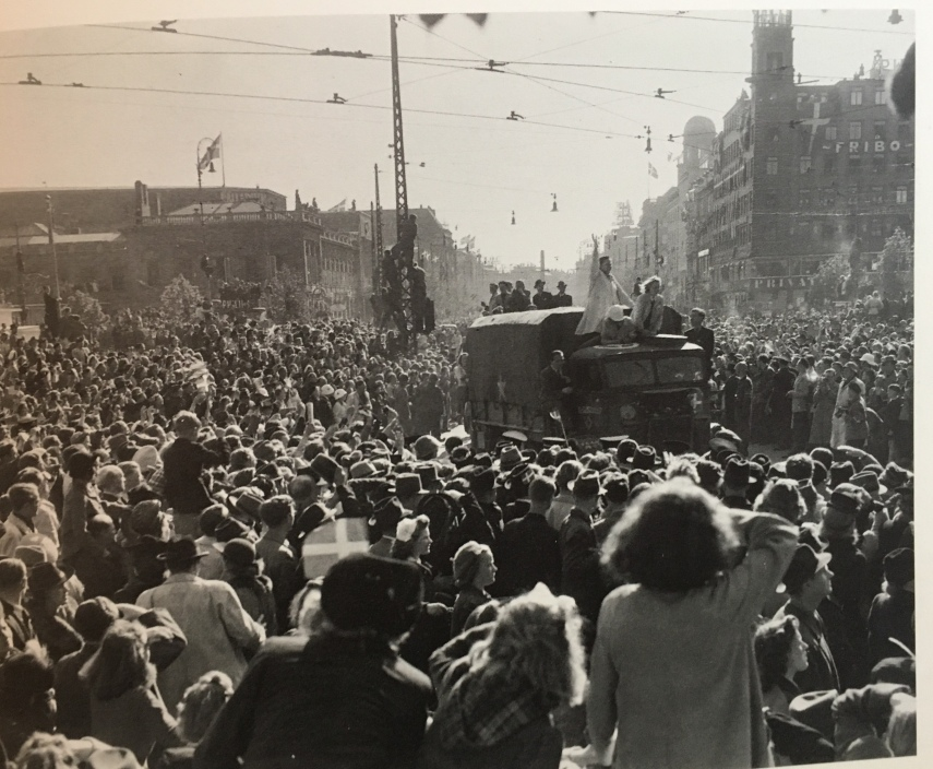 British land troops are greeted at our Town Hall Square in Copenhagen. The tower to the right in the back is the tower where Citroen made his stunt the year before