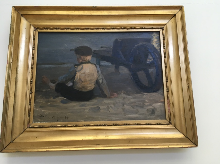 "P.S. Kroeyer ""A Fisher boy sitting beside a wheelbarrow 1884"