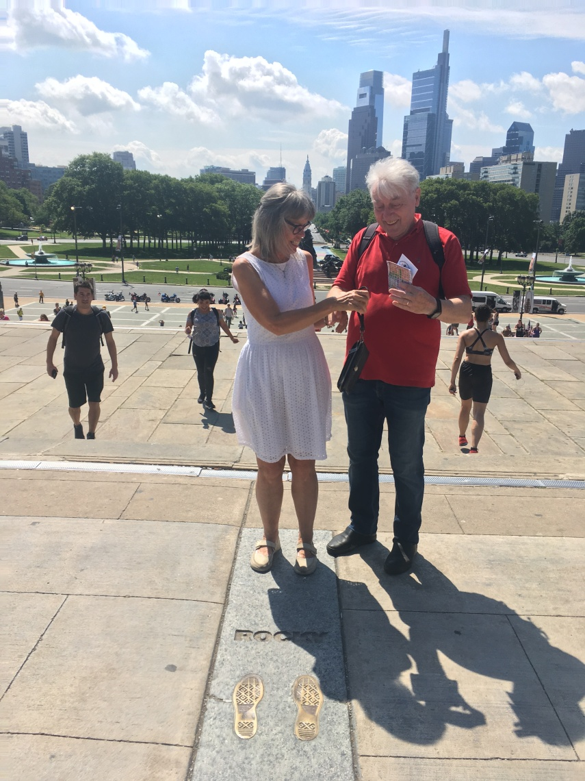 Tourists at the Rocky Steps leading to the Art Museum of Philadelphia