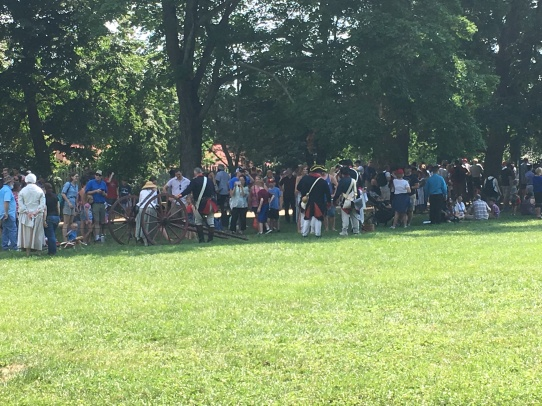 People in costumes from Washington's time are lining up in the shade at the Vernon estate park.