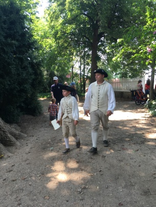 Father and son in costumes from Washington's time at the Vernon estate park.