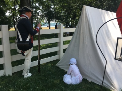 A soldier and his child acting as Washington's Army at Mount Vermont