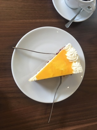 A shared cheesecake at a cafe in Friedrichstad