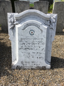 A marble headstone donated from the village to an unknown airman from another date