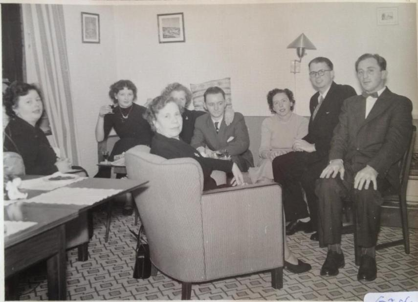The extended table and the furniture in our parents' home in the early 1950s